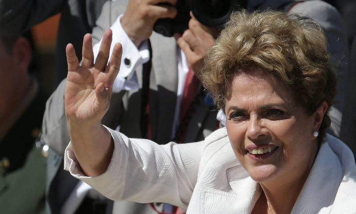 """Brazilian President Dilma Rousseff greets supporters as she leaves Planalto president palace in Brasilia, Brazil, Thursday, May 12, 2016.  Hours after the Senate voted to suspend her, Rousseff blasted the impeachment process against her as """"fraudulent"""" and promised to fight what she characterized as an injustice more painful than the torture she endured under a past military dictatorship. (AP Photo/Eraldo Peres)"""