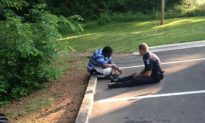 Charlotte Police Officer Photographed Sitting With Suicidal Autistic Teen