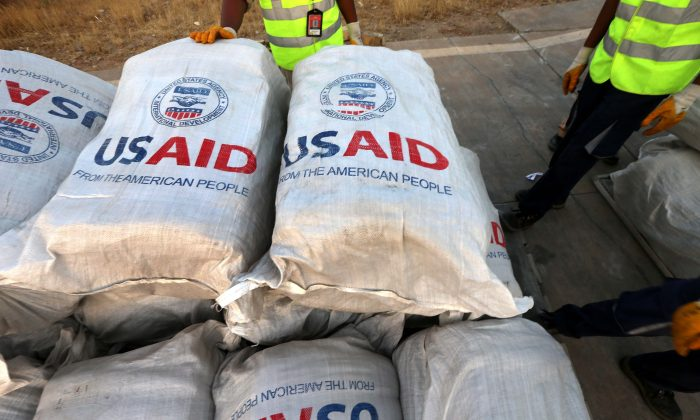 Humanitarian aid supplies  from USAID unloaded from a plane in northern Iraq, on September 2nd, 2014.  USAID has suspended aid for Syria following corruption investigation. (SAFIN HAMED/AFP/Getty Images)