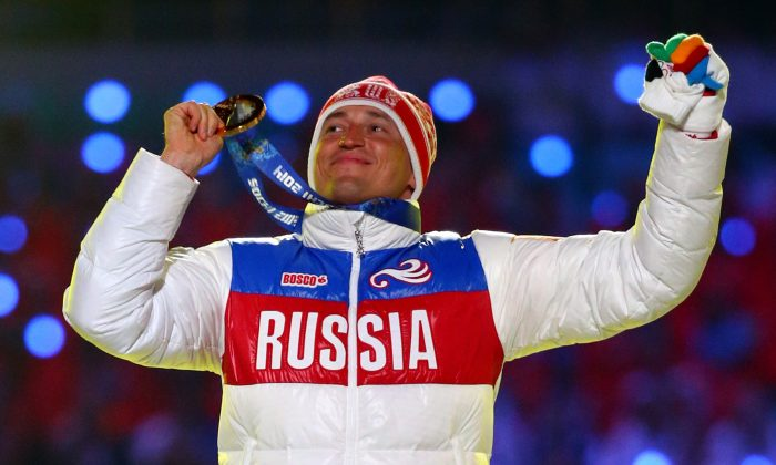 Gold medalist Alexander Legkov of Russia celebrates in the medal ceremony for the Men's 50 km Mass Start Free during the 2014 Sochi Winter Olympics Closing Ceremony at Fisht Olympic Stadium on February 23, 2014 in Sochi, Russia.  (Photo by Ryan Pierse/Getty Images)