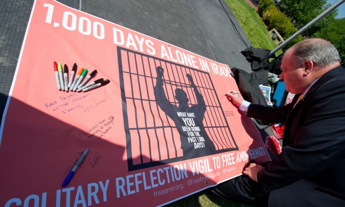 A vigil held in Washington, DC, in the US, on the 1,000th day of US Marine Corps veteran Amir Hekmati's imprisonment in Iran's Evin prison. Falsely accused of spying, now-released Hekmati is suing Iran for prolonged and continuous physical abuse. (KAREN BLEIER/AFP/Getty Images)
