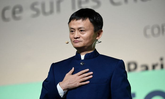 "Chief Executive Officer of the Alibaba Group Jack Ma (Ma Yun) delivers a speech during the ""Action Day"" at the COP21 United Nations conference on climate change in Le Bourget on December 5, 2015. (ERIC FEFERBERG/AFP/Getty Images)"