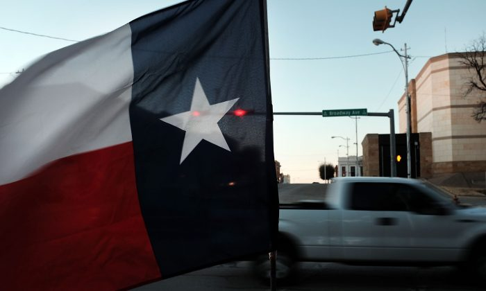 The Texas flag flies in downtown Sweetwater on January 19, 2016.  (Photo by Spencer Platt/Getty Images)
