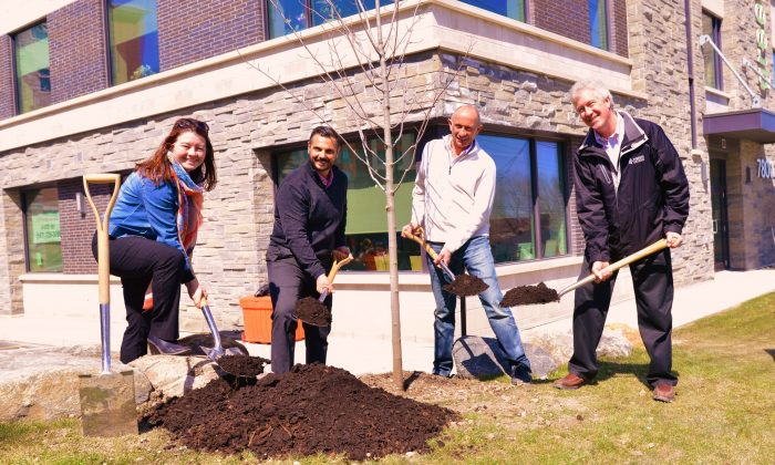 A tree planting ceremony at Del Ridge Homes with Shelley McKay (Forests Ontario), principals George Le Donne and David De Sylva of Del Ridge, and Rob Keen of Forests Ontario (Courtesy of Del Ridge Homes)