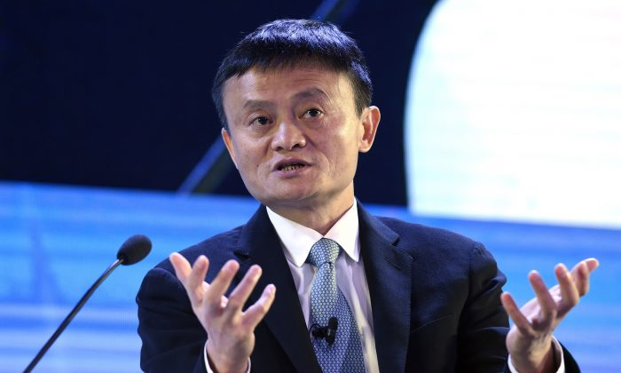 In this Nov. 18, 2015 file photo, Alibaba founder Jack Ma speaks at the CEO Summit, attended by 800 business leaders from around the region representing U.S. and Asia-Pacific companies, in Manila, Philippines, ahead of the start of the Asia-Pacific Economic Cooperation summit.   An investigation by The Associated Press has found that the president of an influential anti-counterfeiting group owns Alibaba stock, has close ties to a key Alibaba vice president and uses family members to run his coalition.  (AP Photo/Susan Walsh, File)