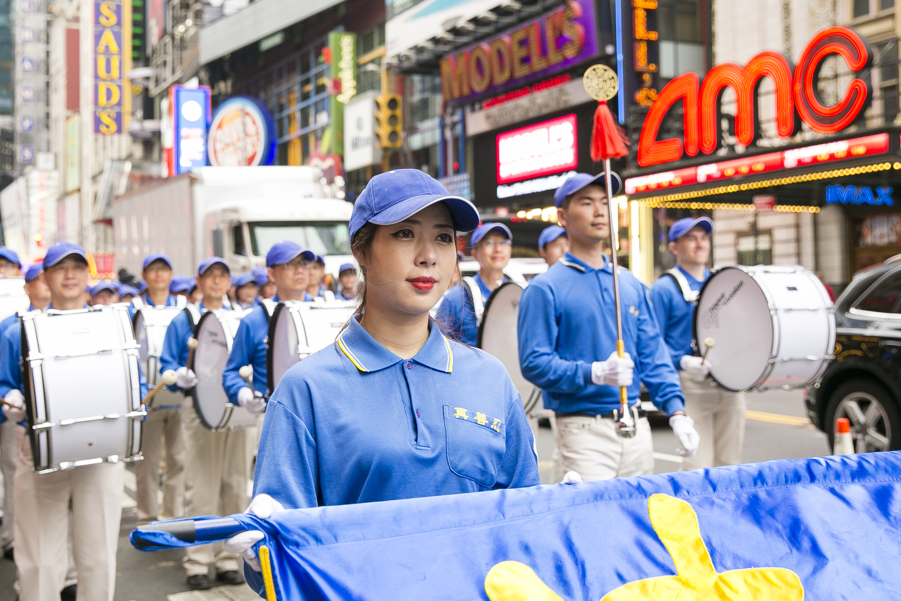 The Tian Guo Marching Band performs in the World Falun Dafa Day parade along 42nd Street in New York, on May 13, 2016. (Samira Bouaou/Epoch Times)