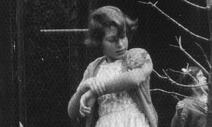 This undated handout photo provided by HM The Queen shows the then Princess Elizabeth with a bird on her arm, in Britain. Rare footage of Britain's Queen Elizabeth has been shared to celebrate her 90th birthday. (HM The Queen via AP)