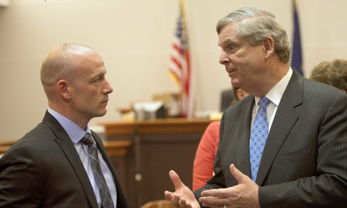 U.S. Secretary of Agriculture Tom Vilsack (R) talks with former heroin addict Chris Overka after a meeting at the Hillsborough County Superior Court in Nashua, N.H., on May 9, 2016. Vilsack, who has been candid about his mother's struggles with alcohol and pills, is leading an Obama administration initiative on rural opioid abuse. He visited Hillsborough County Superior Court in Nashua on Monday to hear about its drug court program, which held its first graduation ceremony last week. (AP Photo/Jim Cole)