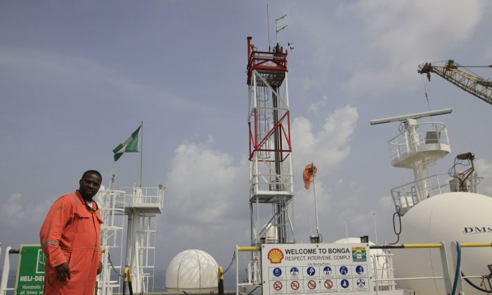 A member of Shell staff on the Bonga offshore oil Floating Production Storage and Offloading vessel off the coast of the Niger Delta in Nigeria no Dec. 26, 2011. (AP Photo/Sunday Alamba)