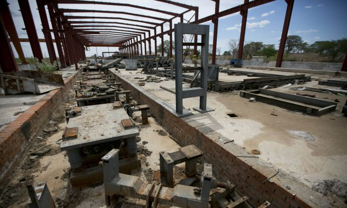 A railroad factory in ruins after it was abandoned by its Chinese managers in Zaraza, Guarico state, Venezuela, on March 21, 2016. Now all but abandoned, it has become a symbol of economic collapse and a strategic Venezuela-China relationship gone adrift. (AP Photo/Ariana Cubillos)
