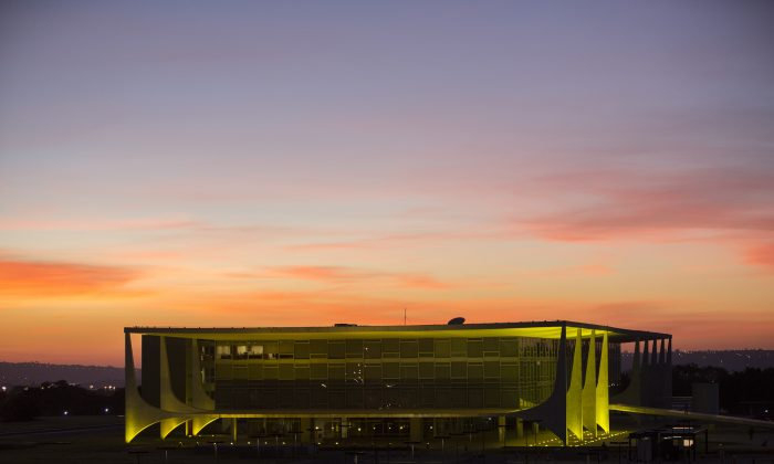 Planalto presidential palace during sunrise in Brasilia, Brazil, after the Senate voted to suspend President Dilma Rousseff pending an impeachment trial, on May 12, 2016. For the sake of the nation's 200 million people, and for all the South American nations whose fortunes are tied to Brazil's powerhouse economy, one hopes that her vice president, now acting president, Michel Temer know what to do. (AP Photo/Felipe Dana)