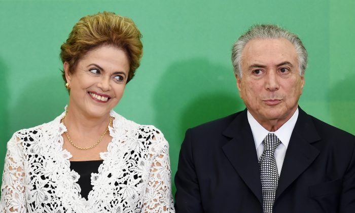 Brazilian President Dilma Rousseff (L) and her Vice President Michel Temer attend the inauguration ceremony of new ministers at the Planalto Palace in Brasilia on Oct. 5, 2015. (Evaristo Sa/AFP/Getty Images)