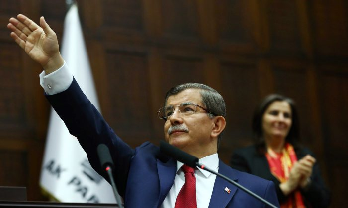 Ahmet Davutoglu, Turkey's outgoing prime minister and leader of Turkey's ruling party, the Justice and Development Party (AKP) arrives for an AKP group meeting at the Turkish parliament in Ankara, on May 3, 2016. (Adem Altan/AFP/Getty Images)