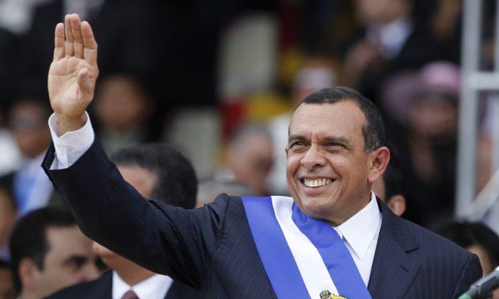 FILE - In this Jan. 27, 2010 file photo, Honduras' President Porfirio Lobo, waves during his presidential inauguration ceremony in Tegucigalpa, Honduras. (AP Photo/Eduardo Verdugo, File)