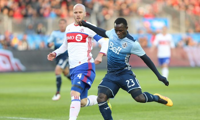 Vancouver Whitecaps winger KekutaManneh scores against Toronto FC in Toronto on May 14, 2016. The Gambian scored two goals against the second best defense in MLS. (The Canadian Press/Peter Power)