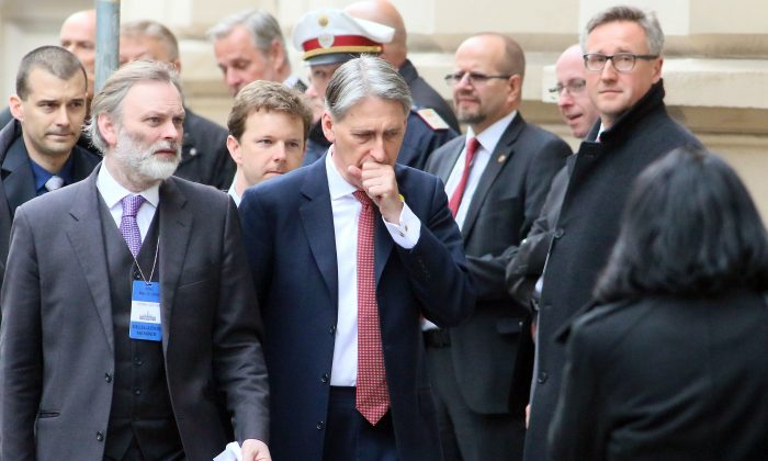 British Foreign Secretary Philip Hammond, center, arrives for Syria talks in Vienna, Austria, Tuesday, May 17, 2016. World and regional powers are meeting in Vienna to overcome stubborn divisions among Syrian factions that have led to the rise of Islamic extremists and claimed hundreds of thousands of lives since violence turned to war five years ago. (AP Photo/Ronald Zak)