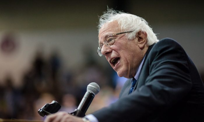 US Democratic presidential candidate Bernie Sanders addresses a campaign rally in Salem, Oregon, May 10, 2016. (Photo credit should read ROB KERR/AFP/Getty Images)