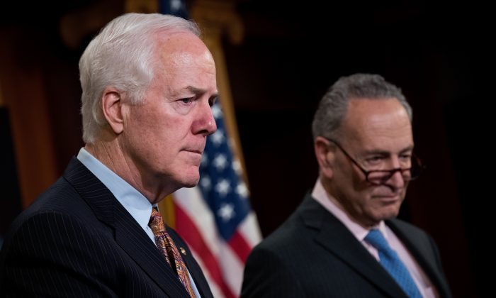 (L-R) Sens. John Cornyn (R-Texas) and Chuck Schumer (D-N.Y.) answer questions during a news conference, in a file photo. (Drew Angerer/Getty Images)