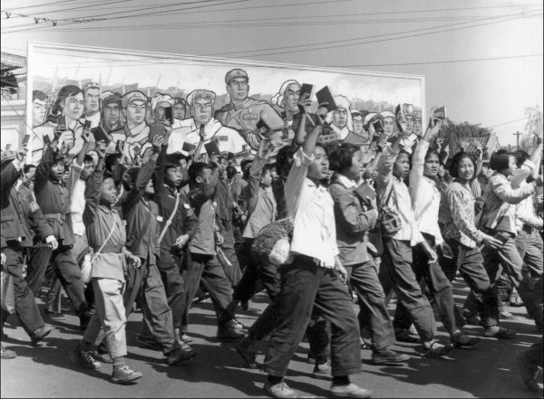 "Chinese Red Guards, high school and university students, waving copies of Chairman Mao Zedong's ""Little Red Book,"" parade in Beijing's streets at the beginning of the Cultural Revolution on June 1966. During China's Cultural Revolution (1966-1976), under the command of Mao, Red Guards rampaged through much of the country, humiliating, torturing, and killing perceived class enemies, and pillaging cultural symbols that were deemed as not representative of the communist revolution. (Jean Vincent/AFP/Getty Images)"