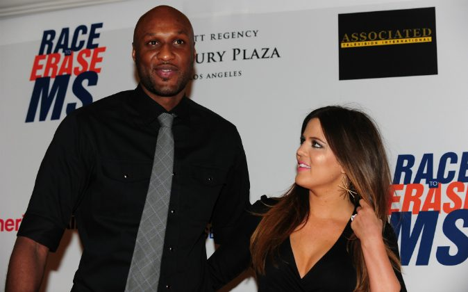 Lamar Odom and Khloe Kardashian-Odom pose on arrival for the 19th Annual Race to Erase MS themed 'Glam Rock to Erase MS' in Los Angeles on May 18, 2012. (FREDERIC J. BROWN/AFP/GettyImages)