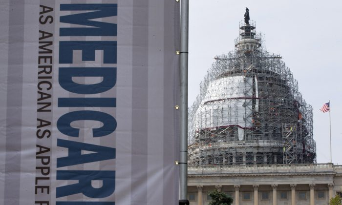 A sign supporting Medicare is seen on Capitol Hill in Washington, on July 30, 2015. (Jacquelyn Martin/AP Photo)