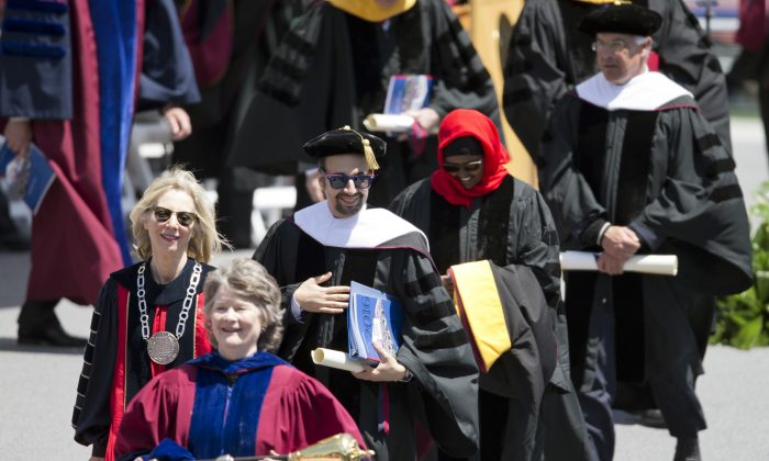 "Lin-Manuel Miranda, creator of the Broadway musical ""Hamilton,"" center left, walks with faculty from the University of Pennsylvania commencement ceremony, Monday, May 16, 2016, in Philadelphia.  (AP Photo/Matt Rourke)"