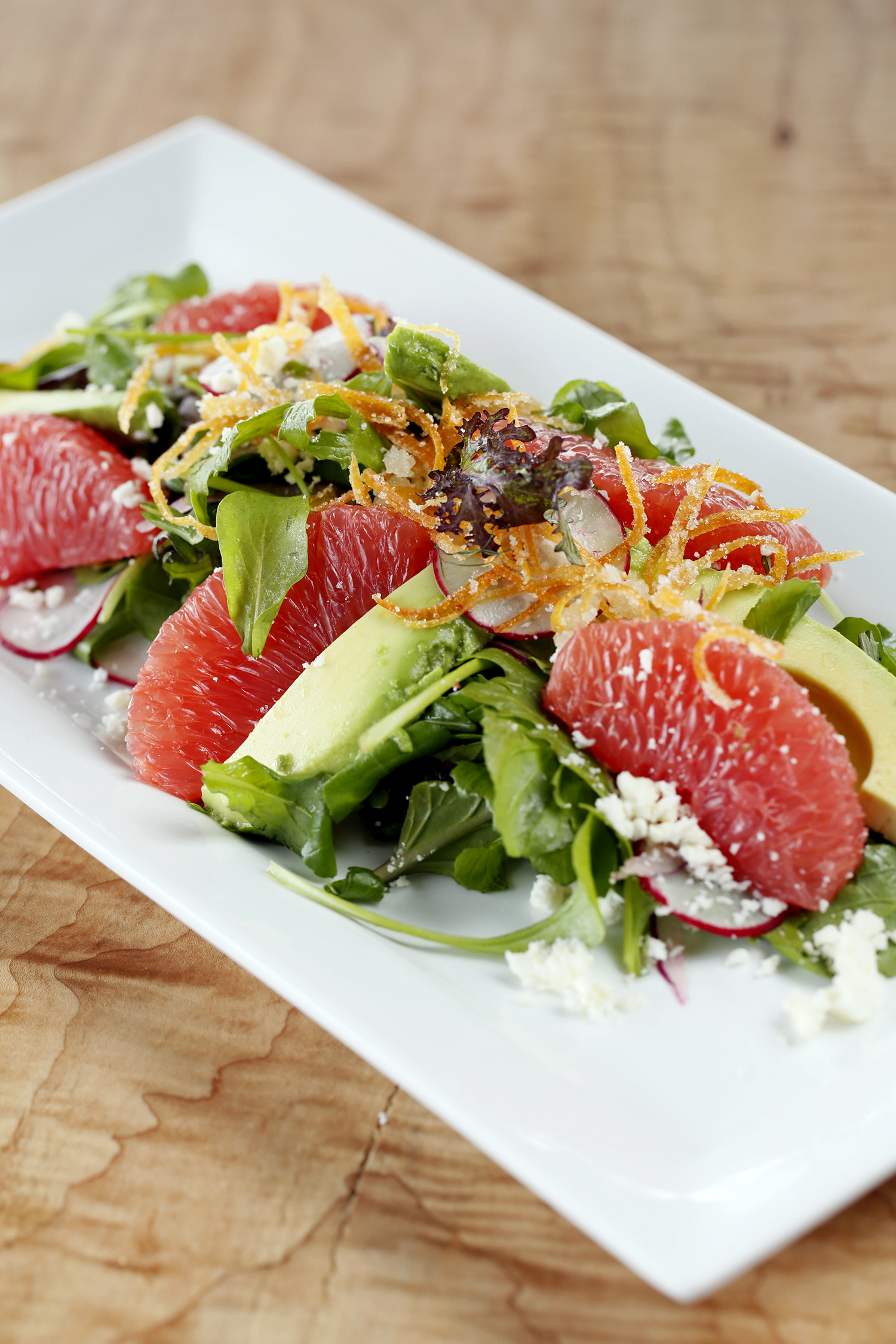 Ruby grapefruit salad with Asian lettuces and candied grapefruit zest at Tinker Street. (Courtesy of Tinker Street)
