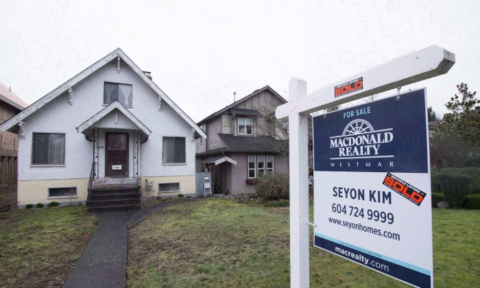 A sold home inVancouver on Feb. 11, 2016. The presence of foreign money is changing the landscape in Vancouver's and Toronto's housing markets. (The Canadian Press/Jonathan Hayward)