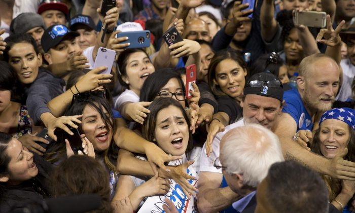 Democratic presidential candidate Sen. Bernie Sanders, I-Vt., greets supporters after speaking at a rally on Tuesday, May 17, 2016, in Carson, Calif. (AP Photo/Jae C. Hong)