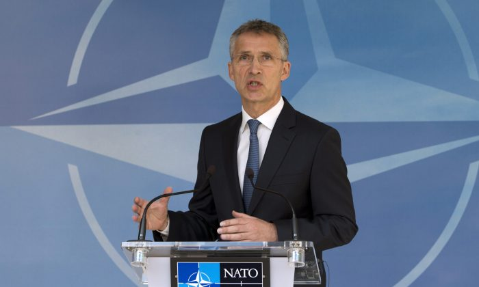 NATO Secretary General Jens Stoltenberg speaks during a media conference at NATO headquarters in Brussels on Thursday, May 19, 2016. NATO foreign ministers this week will discuss how the alliance can deal more effectively with security threats outside Europe, including by training the Iraqi military and cooperating with the European Union to choke off people-smuggling operations in the central Mediterranean. (AP Photo/Virginia Mayo)
