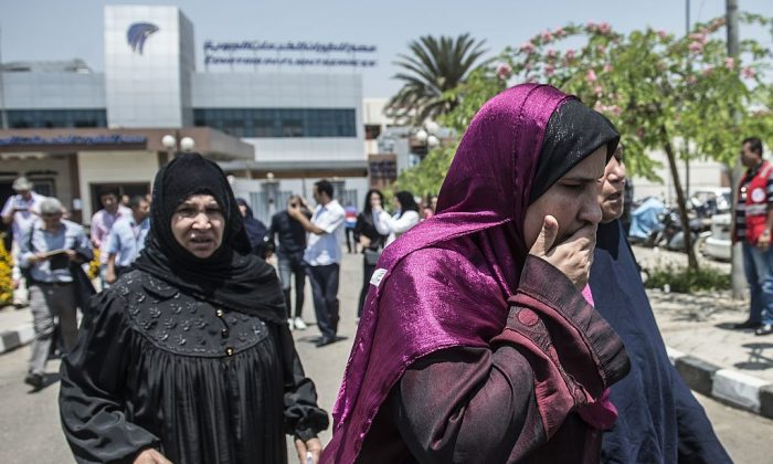 Family members of passengers who were flying aboard an EgyptAir plane that vanished from radar en route from Paris to Cairo overnight get ready to be transported by bus to a gathering point at Cairo airport on May 19, 2016. (KHALED DESOUKI/AFP/Getty Images)