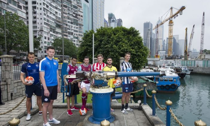 (R-L) Hong Kong Football Club's Gary Gheczy, Leicester City's Elliott Moore, Aston Villa's Khalid Abdo, West Ham United's Lewis Page, Stoke City's Lewis Banks, Wellington Phoenix's Justin Gulley, and Newcastle United's Dan Barlaser at the Noon Day Gun, Causeway Bay on May 19, 2016. (Lucas Schifres/Power Sport Images)