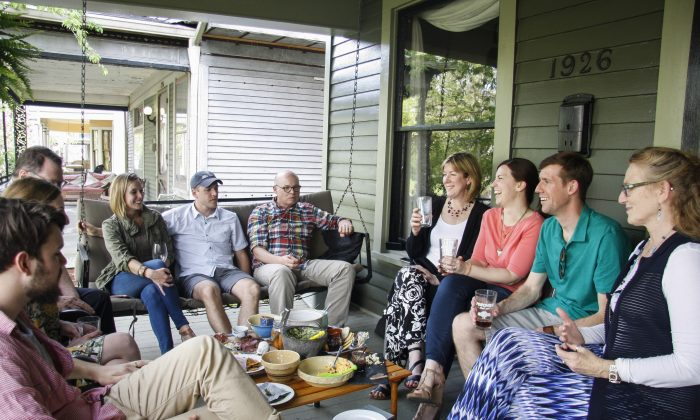 Joanna Taft (4th R) hosts a porching party at her house. (Annie Wu/Epoch Times)