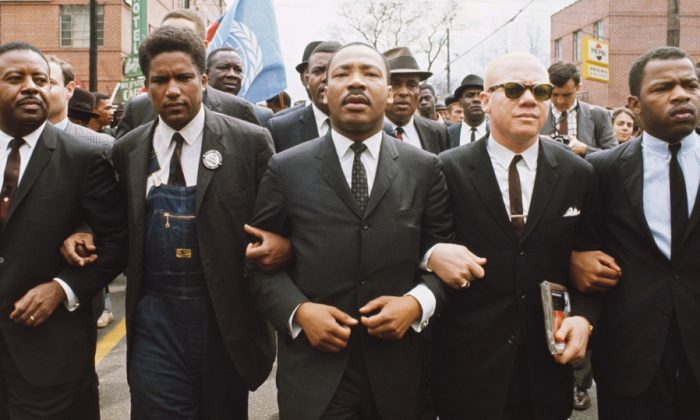 Martin Luther King Jr. (C) leading a march from Selma to Montgomery to protest lack of voting rights for African Americans. In 1963, King wrote 'Letter from a Birmingham Jail' setting out his justification for breaking the law. (Steve Schapiro/Corbis via Getty Images)