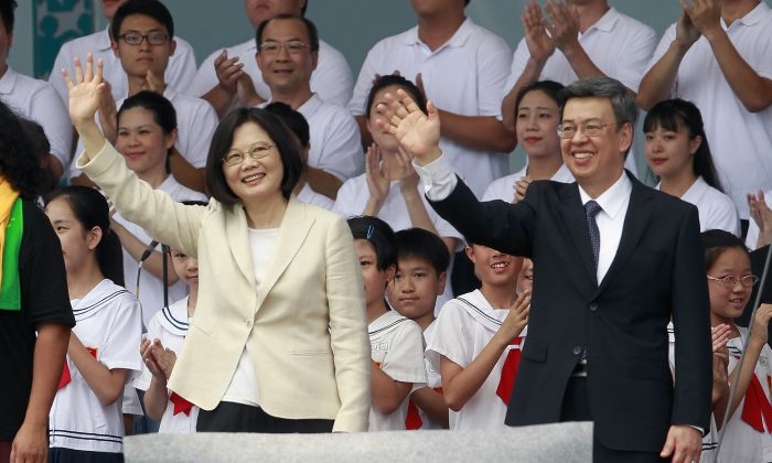New Taiwan's President Tsai Ing-wen, left, and Vice President Chen Chien-jen wave during their inauguration ceremonies in Taipei, Taiwan, Friday, May 20, 2016. (AP Photo/Chiang Ying-ying)