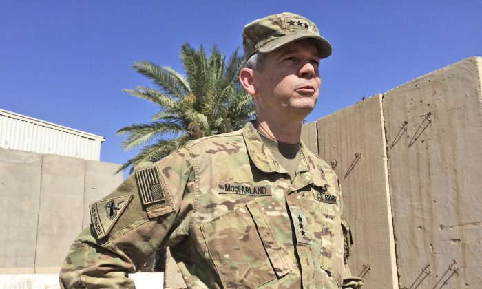 Army Lt. Gen. Sean MacFarland, the top U.S. commander in Baghdad, speaks to reporters in Baghdad, Iraq, Friday, May 20, 2016. Bolstered by U.S. airstrikes, Iraqi ground forces have recaptured the southwestern town of Rutba after Islamic State fighters who had occupied the town for nearly two years fled or put up only light resistance, U.S. military officers said Friday. (AP Photo/Robert Burns)