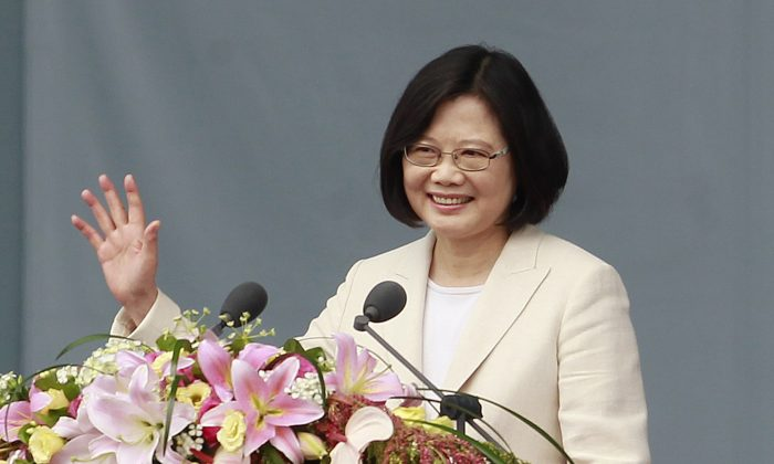 Taiwan's President Tsai Ing-wen waves to Taiwanese people as she delivers an acceptance speech during her inauguration ceremony in Taipei, Taiwan on May 20, 2016. (AP Photo/Chiang Ying-ying)