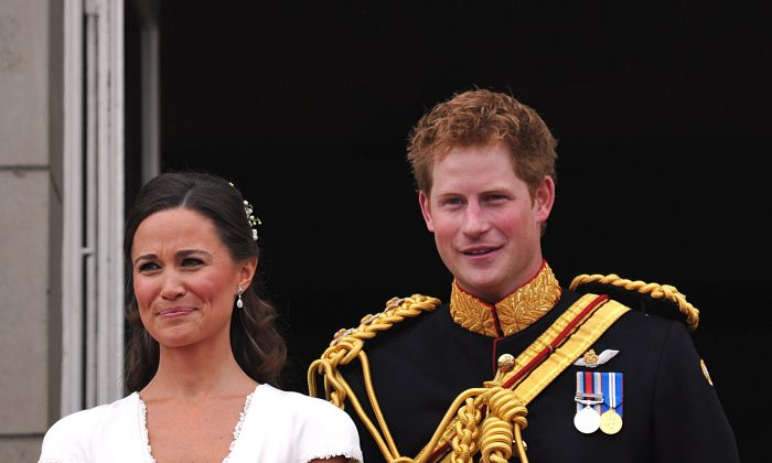 Best man Prince Harry and Maid of Honor Pippa Middleton on the balcony at Buckingham Palace after the Royal Wedding of Prince William to Catherine Middleton on April 29, 2011 in London, England. (Photo by John Stillwell-WPA Pool/Getty Images)