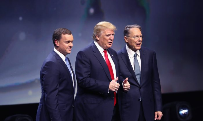 Republican presidential candidate Donald Trump is introduced with Chris Cox (L), Executive Director of the NRA Institute for Legislative Action and Wayne LaPierre (R), Executive Vice President of the National Rifle Association, at the National Rifle Association's NRA-ILA Leadership Forum during the NRA Convention at the Kentucky Exposition Center on May 20, 2016 in Louisville, Kentucky.  (Photo by Scott Olson/Getty Images)