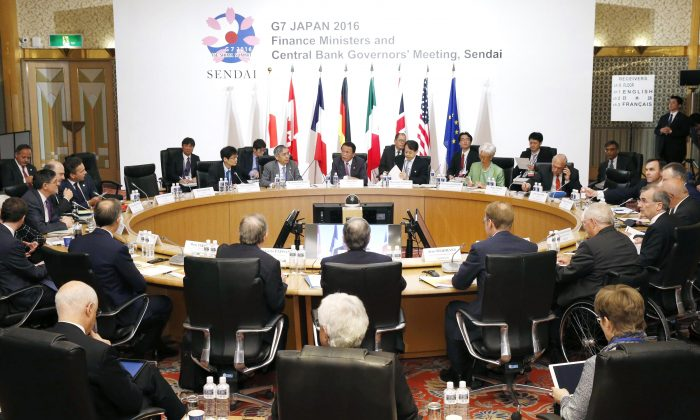 Japanese Finance Minister Taro Aso, center back, presides over a meeting of finance ministers and heads of central banks of the Group of Seven in in Sendai, northern Japan, Friday, May 20, 2016. (Yohei Kanezashi/Kyodo News via AP)