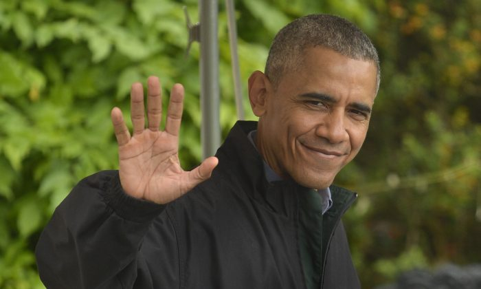 President Barack Obama waves to the press as he departs the White House for his week-long trip to Japan and Vietnam, in Washington, D.C., on May 21, 2016. (Mike Theiler/Getty Images)