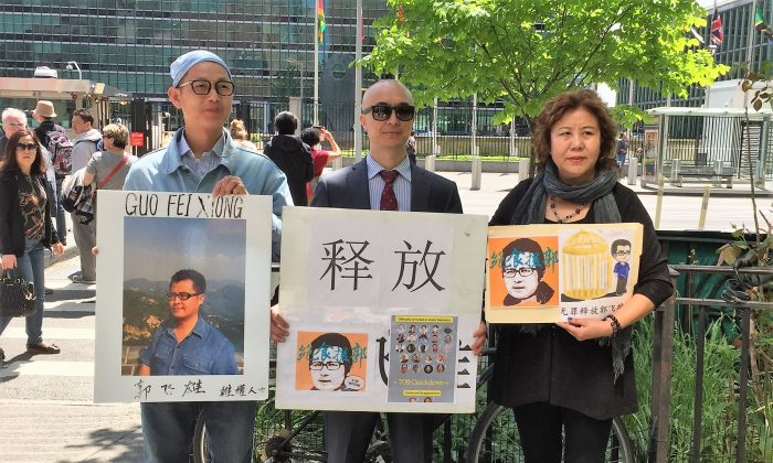 Zhong Jinhua (center) stands with Chen Shisheng, a member of Independent Chinese PEN Center who now lives in forced exile (left), and Lü Jinghua, a June 4 activist, a petitioner from Shanghai (right), on May 20, outside the United Nations Headquarters in New York City. (Eva Fu/Epoch Times)