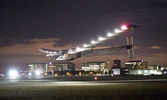 Solar Impulse 2 lands at Moffett Field in Mountain View, Calif., April 23, 2016, completing the leg of its journey from Hawaii in its attempt to circumnavigate the globe. A solar-powered airplane that landed in Oklahoma last week is headed to Ohio on the latest leg of its around-the-world journey. The Swiss-made Solar Impulse 2 took off from Tulsa International Airport about 5 a.m. Saturday, May 21, 2016, with a destination of Dayton, Ohio. The flight was expected to take about 18 hours. (AP Photo/Noah Berger)