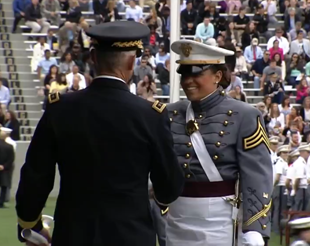 Lt. Gen. Robert Caslen Jr., superintendent of the U.S. Military Academy (L) gives diploma to cadet at commencement ceremonies at West Point on May 21, 2016. (courtesy West Point)