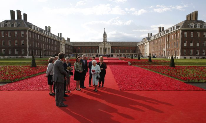 LONDON, ENGLAND - MAY 23:  Queen Elizabeth II visits the 5000 Poppies Garden at Chelsea Flower Show press day at Royal Hospital Chelsea on May 23, 2016 in London, England. The show, which has run annually since 1913 in the grounds of the Royal Hospital Chelsea, is open to the public from 24-28 May.  (Photo by Adrian Dennis - WP Pool/Getty Images)