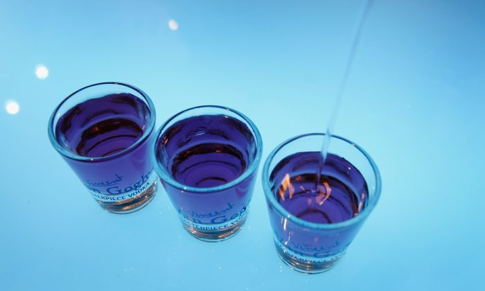 Shot glasses of flavored vodka are poured at the Barman's 2009 drinks fair on June 29, 2009 in Tel Aviv, Israel. (David Silverman/Getty Images)