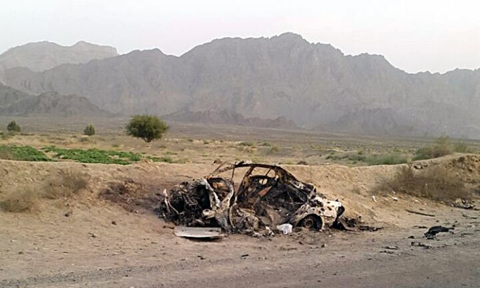 The scene of the U.S. drone strike said to have killed the Taliban leader Mullah Akhtar Mohammad Mansoor on May 22, 2016, while he was traveling in the Ahmad Wal area in Baluchistan Province, Pakistan, near Afghanistan's border. (AP Photo/Abdul Salam Khan)