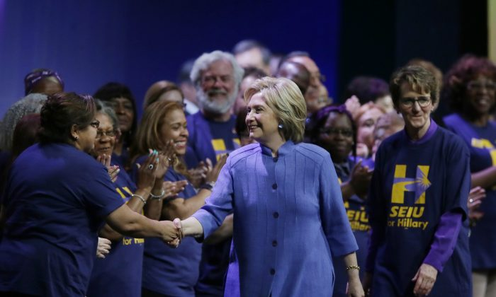 Democratic presidential candidate Hillary Clinton meets with Service Employees International Union (SEIU) members at the union's 2016 International Convention, Monday, May 23, 2016, in Detroit. (AP Photo/Carlos Osorio)