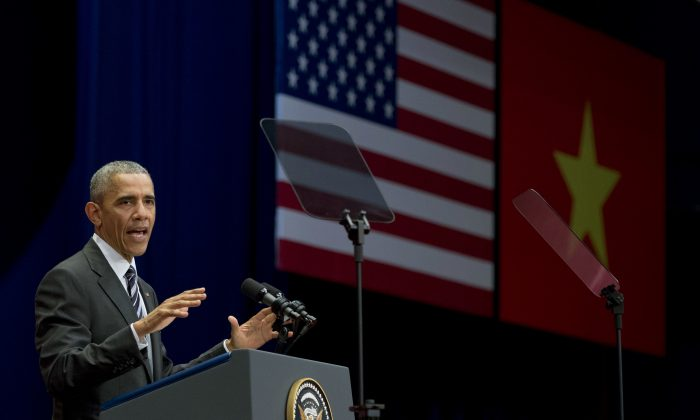 U.S. President Barack Obama speaks at the National Convention Center in Hanoi, Vietnam, Tuesday, May 24, 2016. After knocking down one of the last vestiges of Cold War antagonism with a former war enemy, Obama on Tuesday took his push for closer ties directly to the Vietnamese people, meeting with activists and entrepreneurs and arguing that better human rights would boost the communist country's economy, stability and regional power. (AP Photo/Carolyn Kaster)