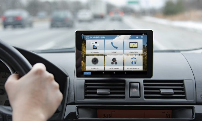 A car dashboard is seen equipped with Rand McNally tablet, for entertainment and GPS features. (PRNewsFoto/Rand McNally)